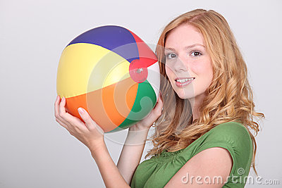 Girl holding  beach ball