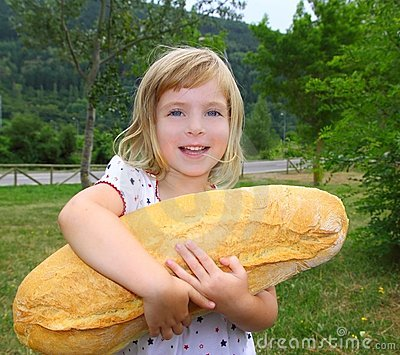 Girl holding big bread humor size hungry child