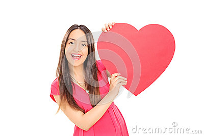 Girl holding a big red heart
