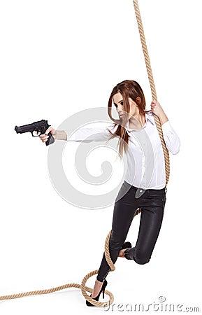 Girl holding a black gun