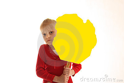 Girl holding blank yellow sign