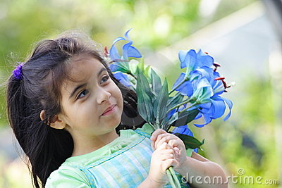 Girl Holding Blue Flowers