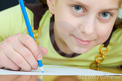 Girl holding a blue pencil