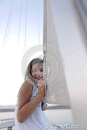 Girl holding boat sail