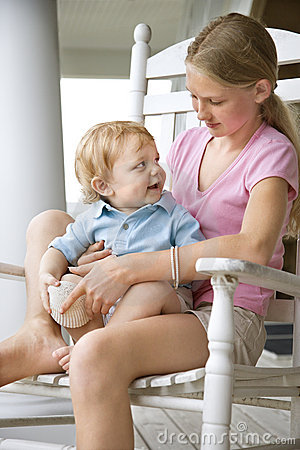 Girl Holding Boy Toddler. Stock Image - Image: 2051651