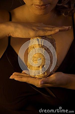 Girl holding buddha statue