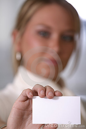 Girl holding business card focus