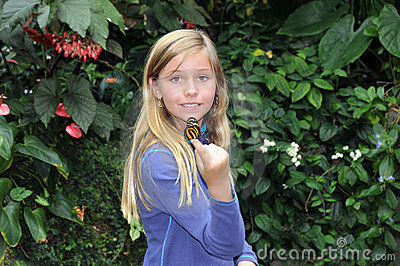 Girl holding butterfly.
