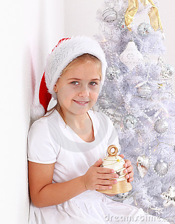 Girl holding Christmas bell
