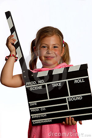 Girl holding a clapperboard