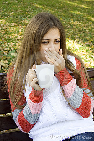 Girl holding coffee cup