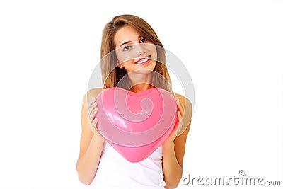 Girl holding decorative heart