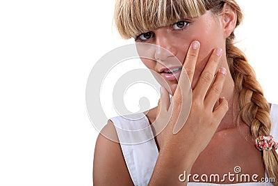 Girl holding face