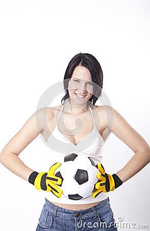 Girl holding a football.