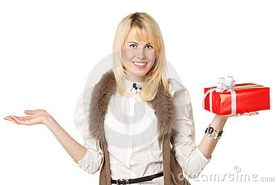 Girl holding gift box and copy space on open palm