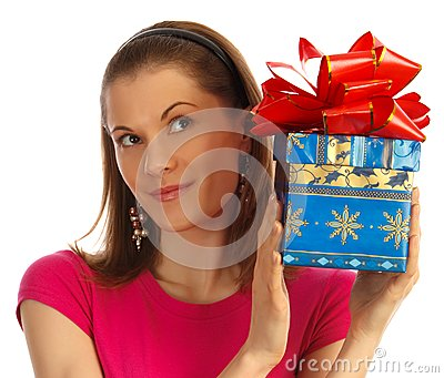 Girl holding a gift. Isolated on white