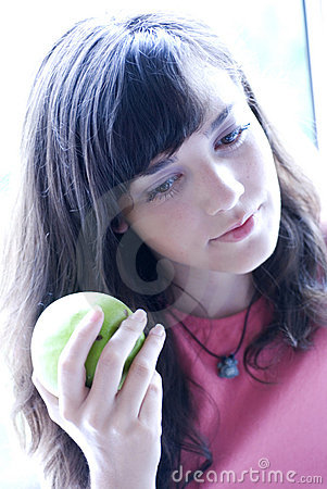 Girl holding green apple
