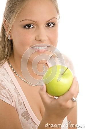 Girl holding green apple