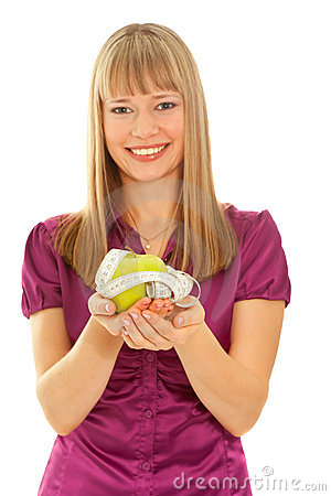 Girl holding a green apple (focus on apple)