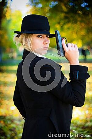 A girl holding a gun.