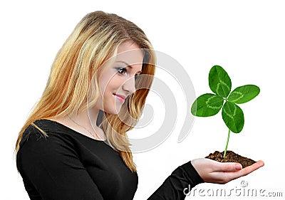 Girl holding in hand clover quarterfoil