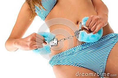 Girl holding handcuffs