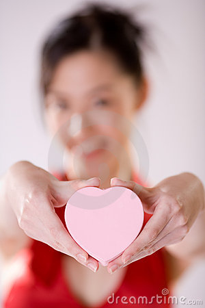 girl holding heart shape box