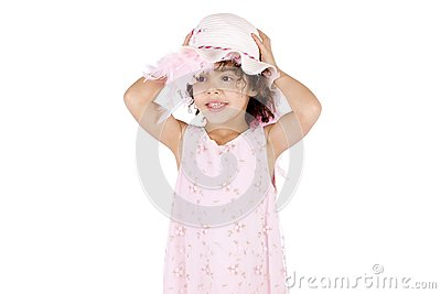 Girl holding her hat