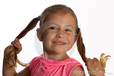Girl holding her pony tails