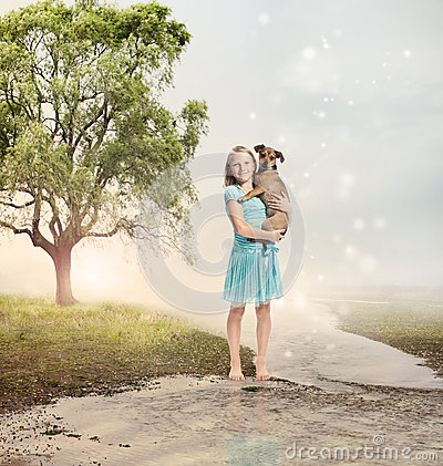 Girl Holding Her Puppy At A Magical Brook Stock Images - Image: 28682194