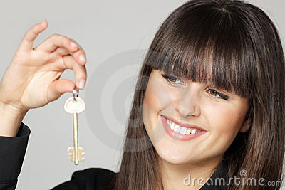 Girl holding a home key