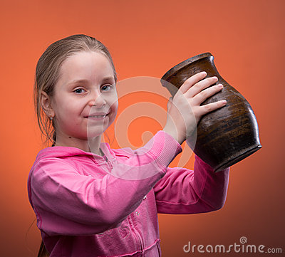 Girl holding a jar