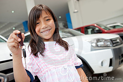 Girl holding keys of a car