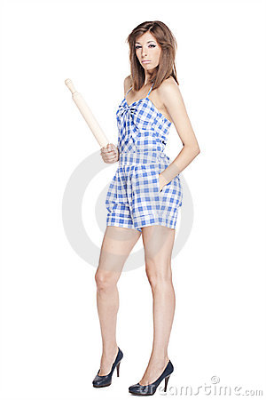Girl holding a kitchen paddle on a white backgroun