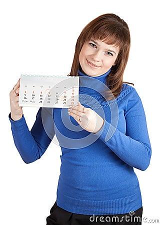 Girl holding loose-leaf calendar