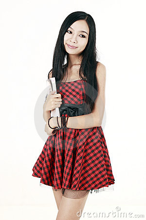 Girl holding a magazine