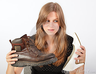 Girl holding male and female shoe