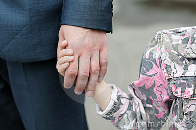 Girl holding an man s hand
