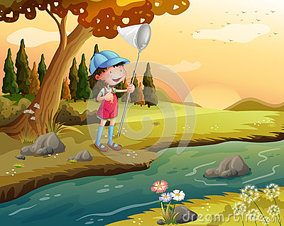 A girl holding a net along the river