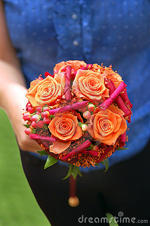 Girl holding an orange bouquet
