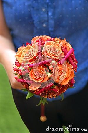 Girl holding an orange bouquet