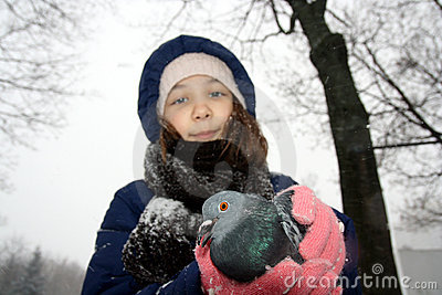 Girl holding pigeon