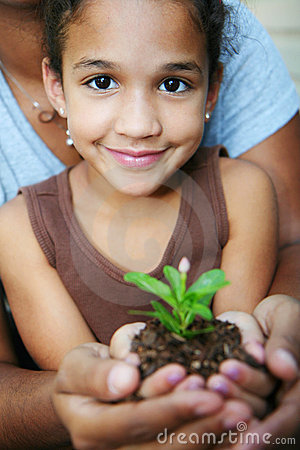 Free Girl Holding Plant Stock Images - 4977754