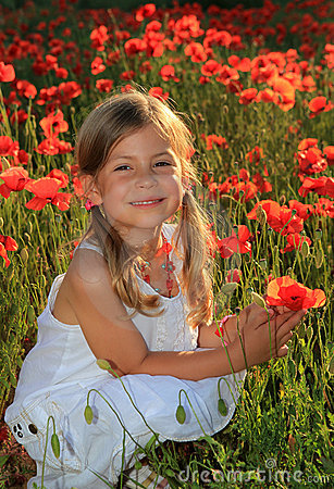 Girl holding poppy