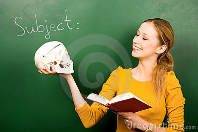 Girl holding skull and book
