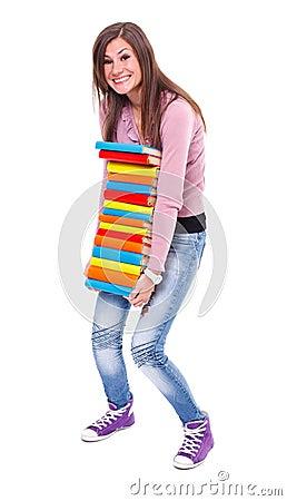 Girl holding stack of books
