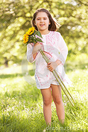 Girl Holding Sunflower In Field