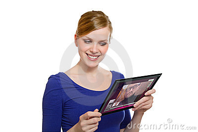 Girl holding a tablet pc und uses the video chat