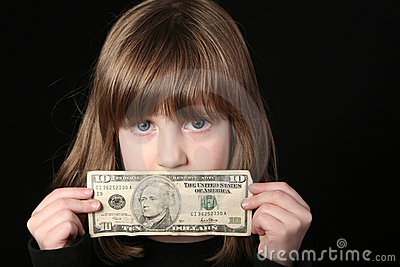 Girl holding ten dollar bill