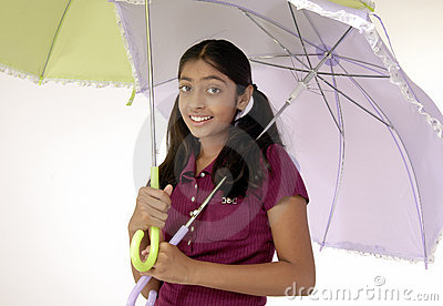 Girl holding two umbrella